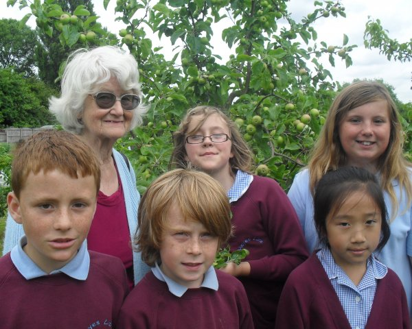 Mary Eastwood with pupils from Heyes Lane School.