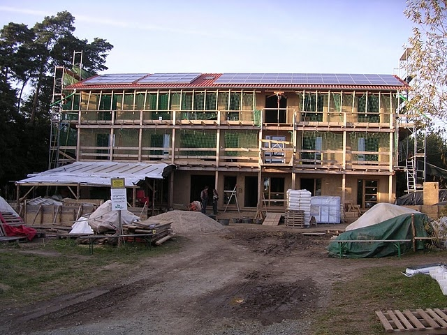A strawbale building under construction at Sieben Linden eco-village in Germany