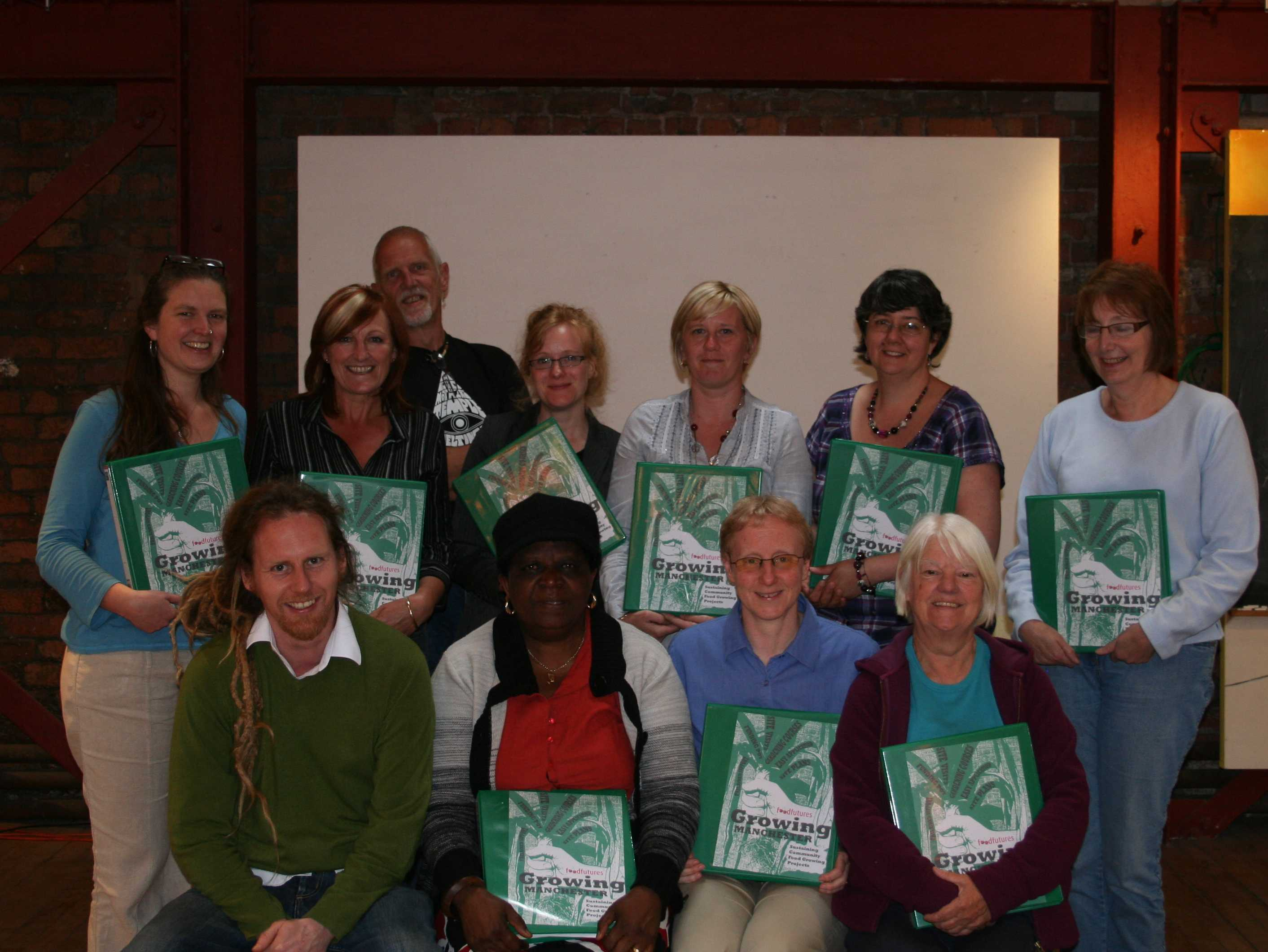 Strong Roots participants with their information packs.