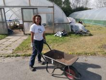 Nicola with a wheelbarrow