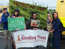 Kindling team with fracking banner