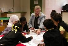 Pupils of St. Margaret's Primary School exploring old maps of Whalley Range.
